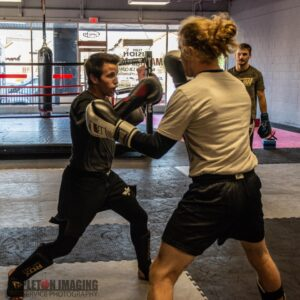 Photo of Two Students Sparring